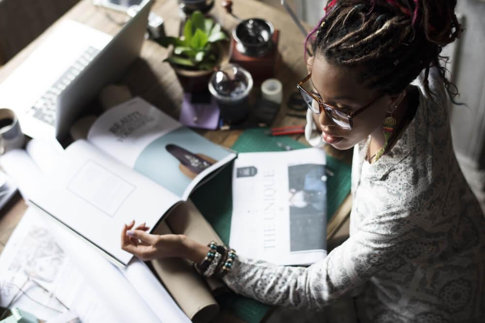 businesswoman-sitting-working-at-office-PTJCWSV